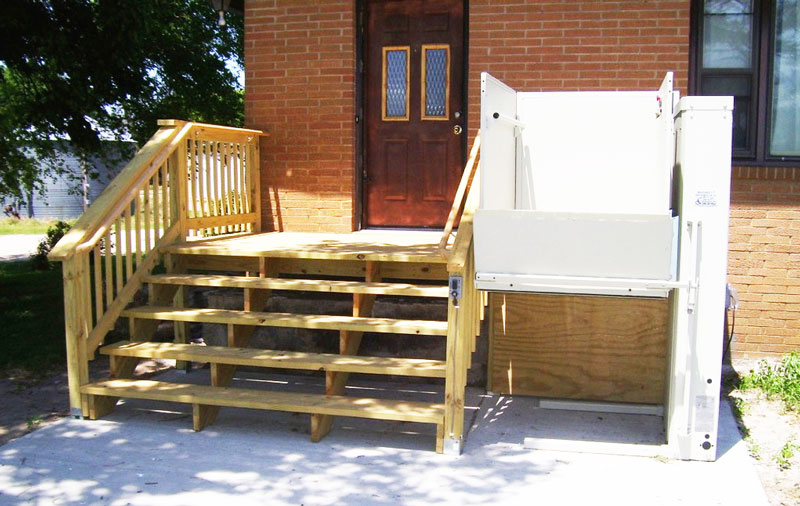 Home wooden porch steps with lift attached to the right side