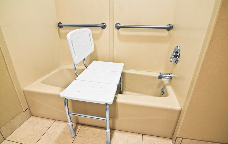 Bathroom tub with seat and grab bars